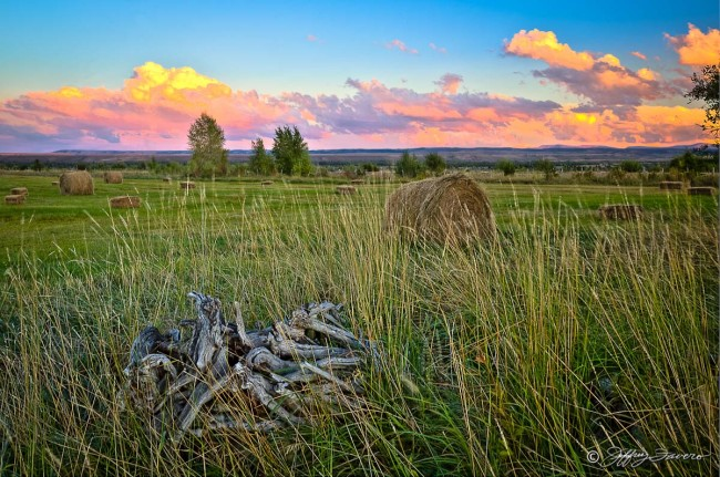 Colorful Sky And Hay Bales