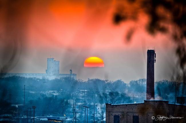 Sunset Amidst Smoke Stacks
