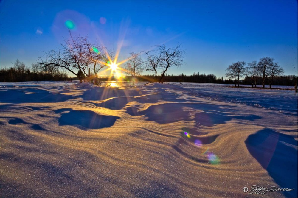 Sun And Sculpted Snow