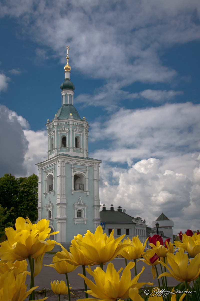 Yellow Flowers And Church Tower