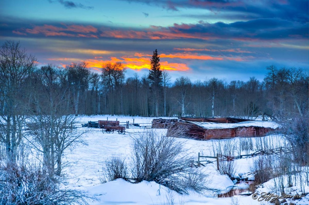 Sunset Over Winter Cabins
